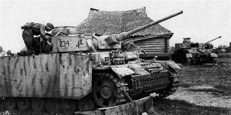 Russian soldier inspect an abandoned(?) PZ III, Russia